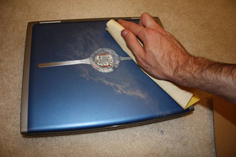 Sanding your laptop case (click for full-size image).