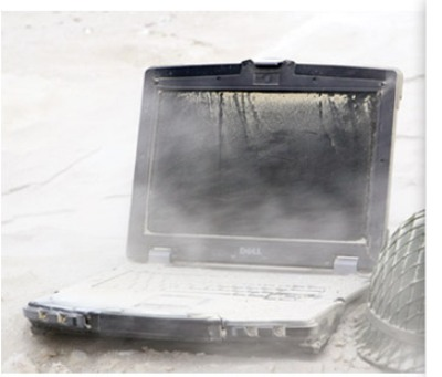 dirt piled on laptop