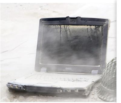 dirt piled on laptop
