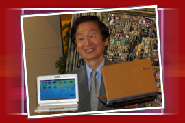 Asus Chairman and CEO Jonny Shih with the EEE PC and the leather bound EEE PC