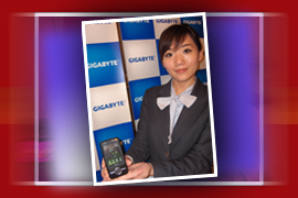 A company spokes-model with the GSmart MS820 smart phone from Gigabyte