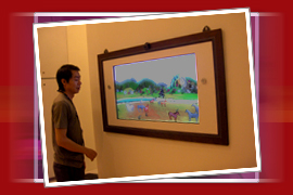 A LCD painting of horses. A person can move his hand across screen to move the horses.